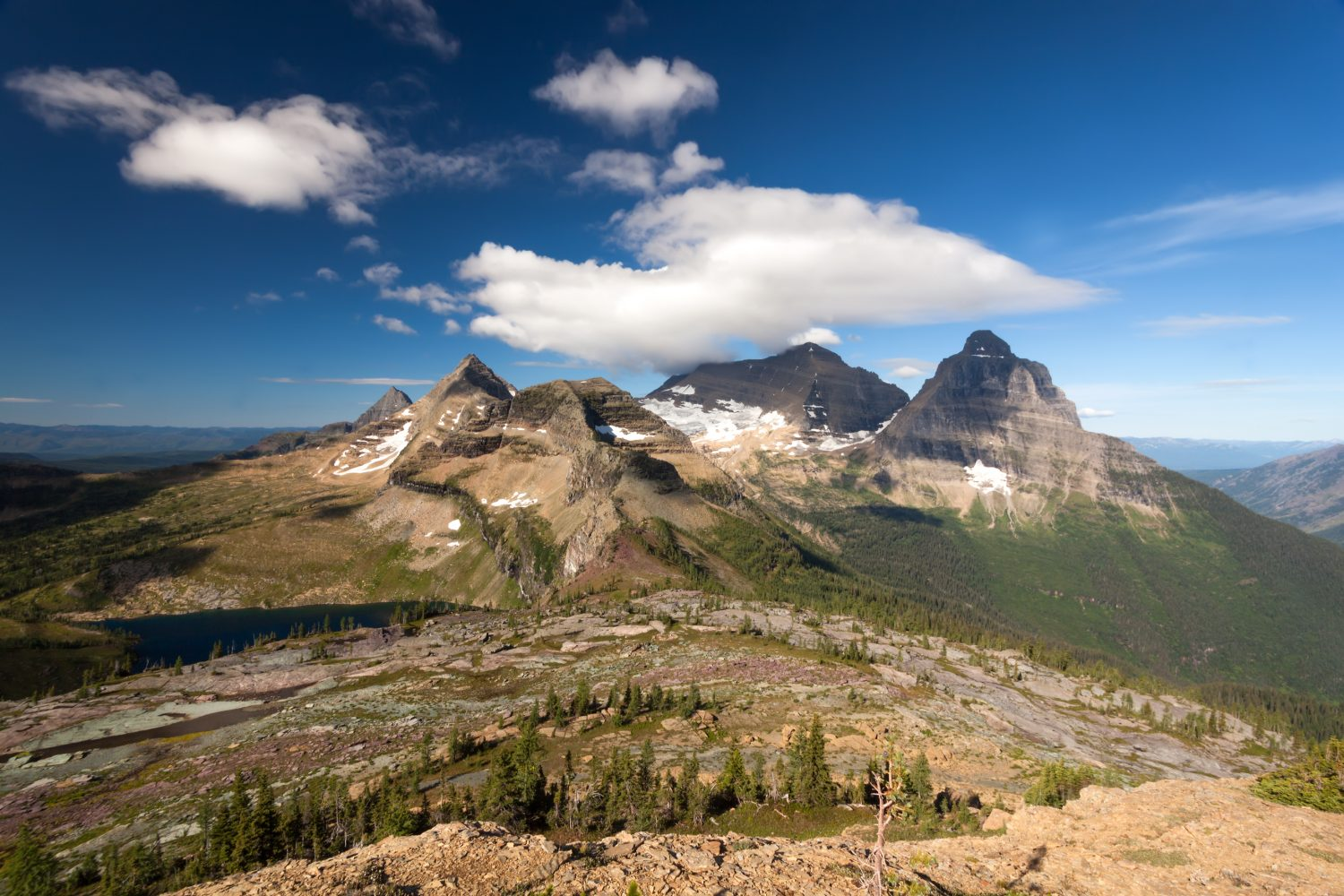 """""""Kinnerly and Kintla"""" Two imposing massifs standing high above Glacier National Park, Montana on the Canadian Border. This image was captured from the summit of Boulder Peak. f/22 @ 1/15 sec using a 17mm lens and a Polarizing Filter. www.backcountryjourneys.com/blog/2015/11/kinnerly-and-kintla #glacier #montana #photography"""