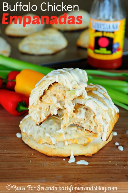 Easy Buffalo Chicken Empanandas - These are awesome and make a perfect easy dinner or snack for game day!  https://backforseconds.com  #snack #easydinner #buffalochicken #cheese