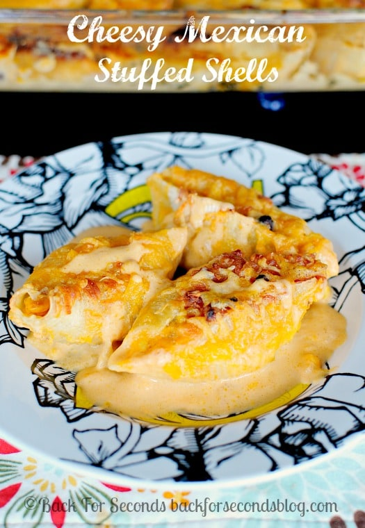 Mexican Stuffed Shells - Cheesy comfort food at it's best! Makes an excellent FREEZER Meal too!  #mexicanfood #freezermeal #stuffedshells