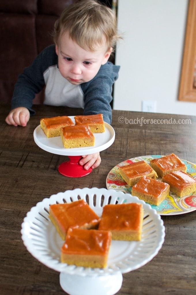 Baby sneaking pumpkin brownies