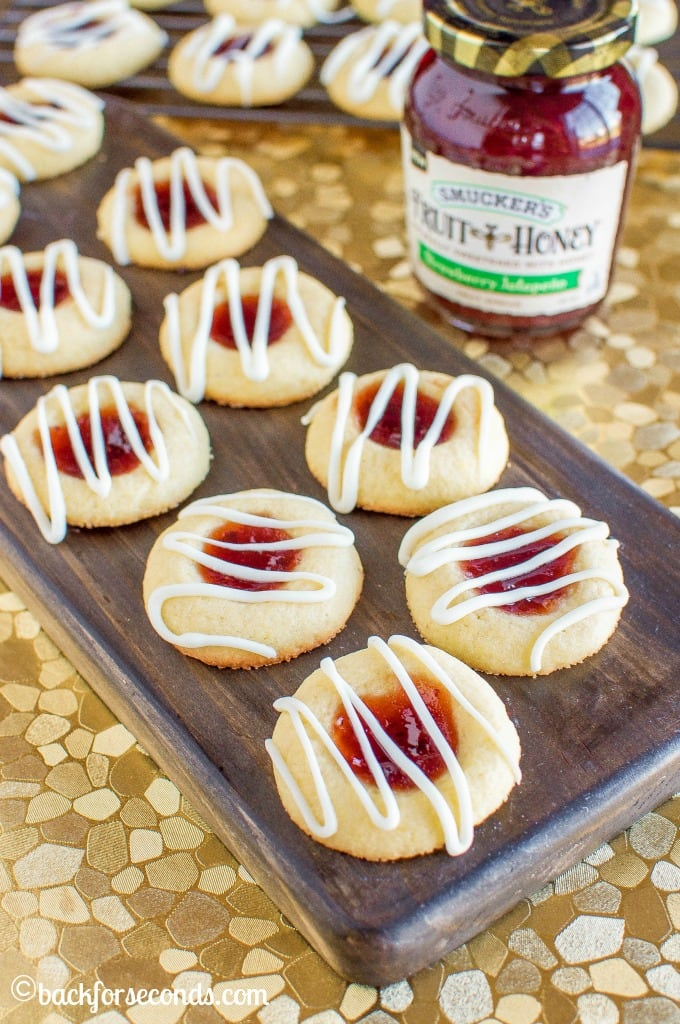 Cornmeal Thumbprint Sugar Cookies with Strawberry Jalapeño Jam, and a white chocolate drizzle, are a so full of flavor that will delight your tastebuds!