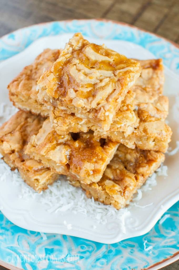 Caramel Coconut Blondies are an easy dessert that will tickle your taste buds! Chewy blondies are loaded with coconut, and swirled with ribbons of caramel!