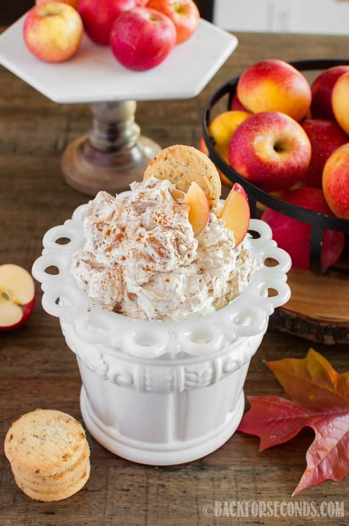 No bake Apple Pie Cheesecake Fluff has all the flavors of apple pie and cheesecake, in one easy dip! A great side dish or dessert for holidays and parties!