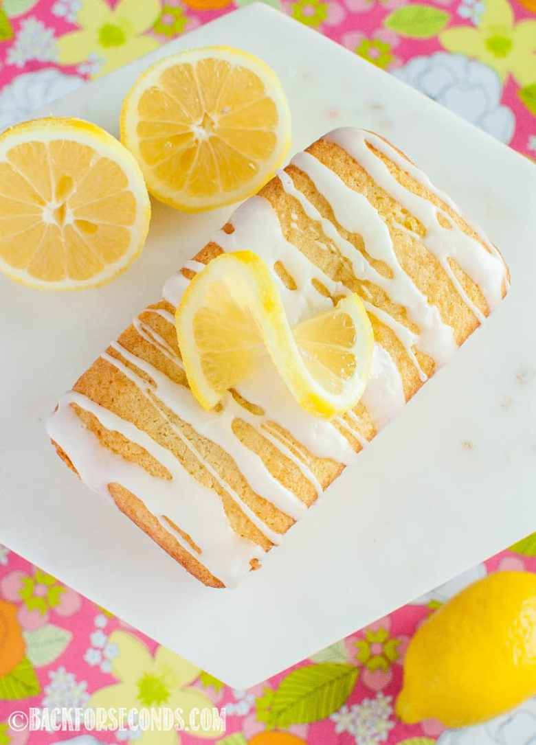 looking down on Best Glazed Lemon Loaf on marble cake stand