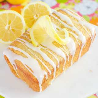 glazed lemon loaf with twist of lemon on top