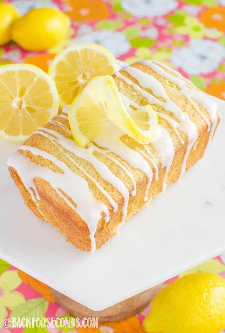 Glazed Lemon Loaf on marble cake stand