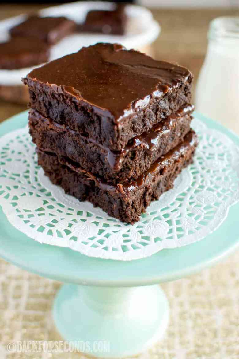 Dark Chocolate Brownies with Cooked Icing on green cake stand