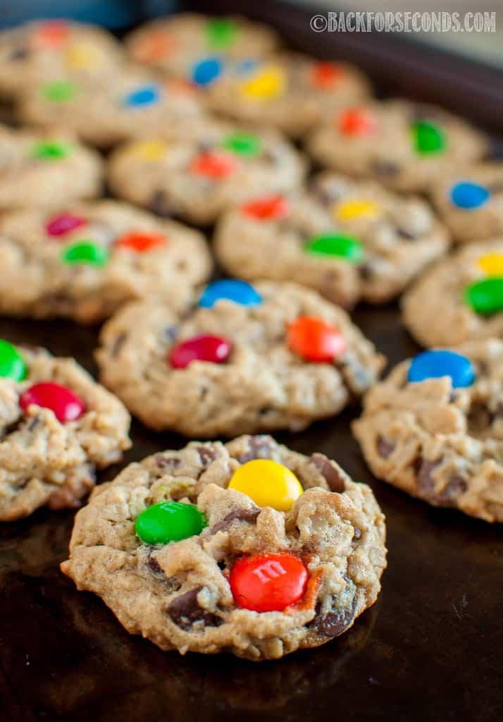 Best Monster Cookies on a dark cookie sheet