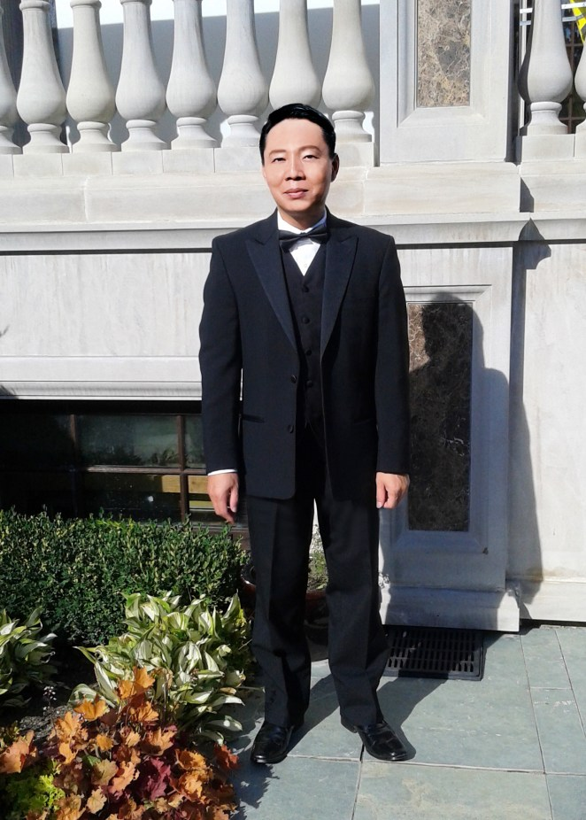 philip yao in tuxedo full body cell pic