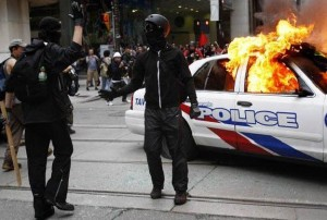 Black Bloc left alone to create carnage and photo ops.