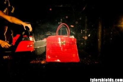 Image: Birkin handbag being chainsawed
