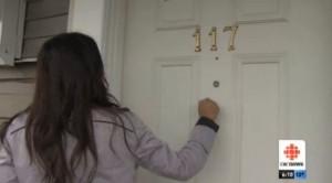 CBC reporter knocking on door
