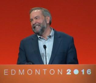 """Thomas Mulcair at NDP convention, """"smiling"""""""