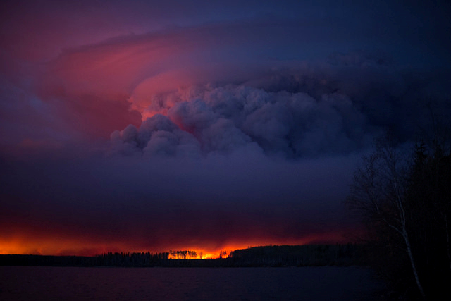Flames reflected in clouds