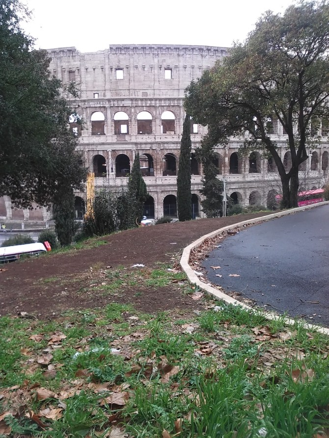 Daylight view of my sleeping spot in the park with the Colosseum in the background