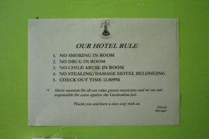 Girls Who Travel | A sign in our first hotel in Cambodia explicitly stating no child abuse allowed