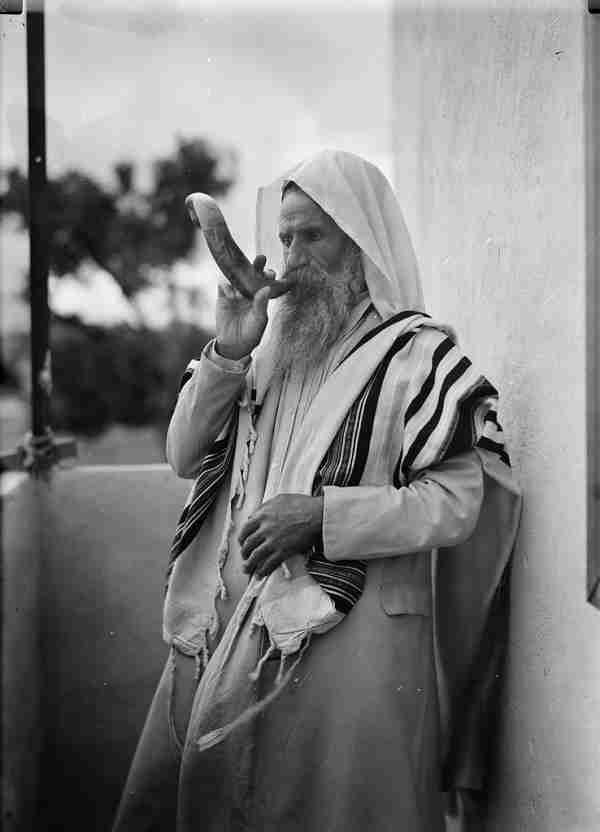 A man blowing a shofar