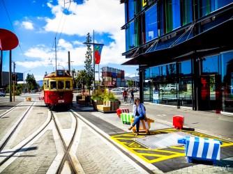 Tram running through city