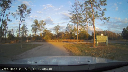 View of dirt road through car windshield