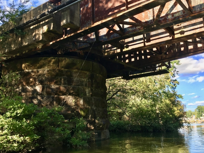 rusty trestle over a river