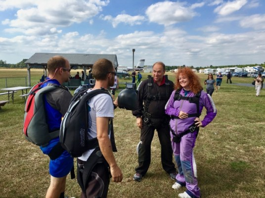 suited up skydivers
