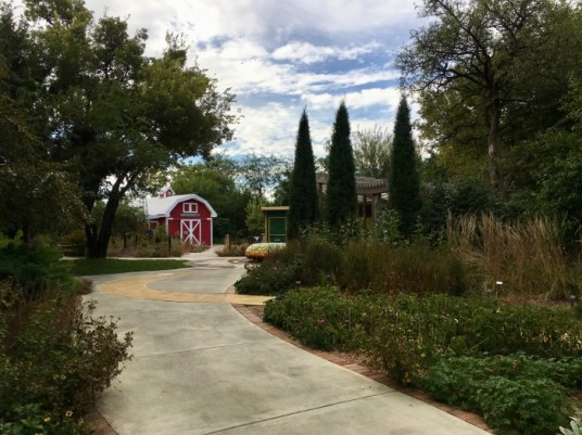 garden with red barn