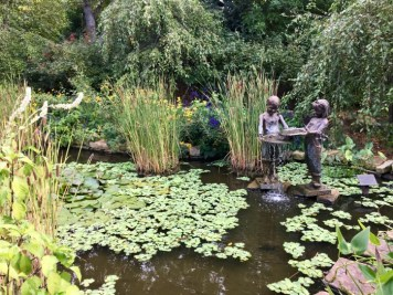 garden pond with statue of children