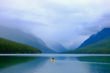 Kayak on lake with mountains