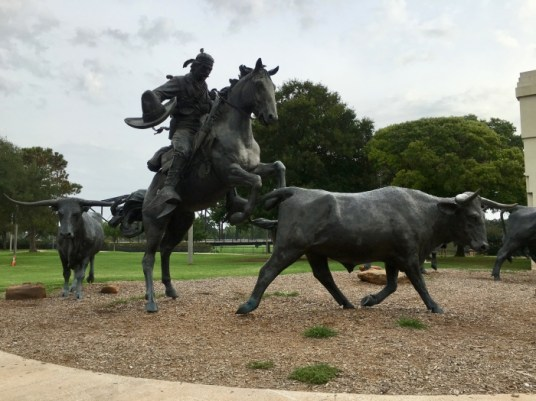cowboy and steer statues
