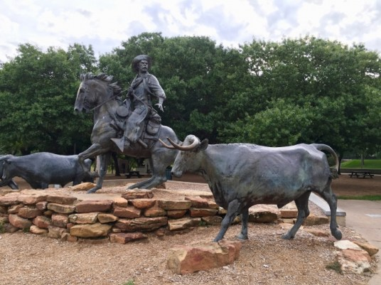 cowboy and steers statues