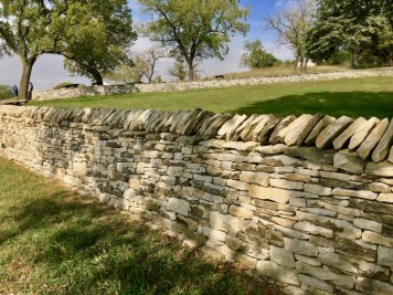 stone fence and trees