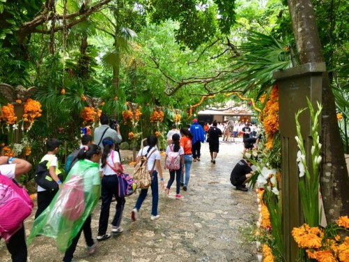 Xcaret theme park guests and marigolds