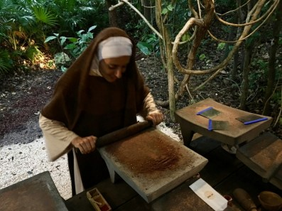 nun using a metate