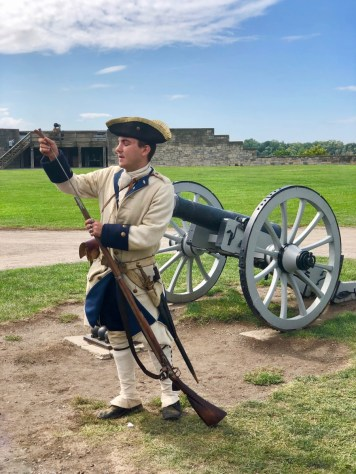 colonial soldier loading a musket