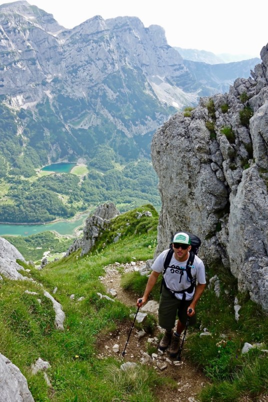 Man hiking up mountain - Roadtripping, Hiking & Camping Montenegro Best Places