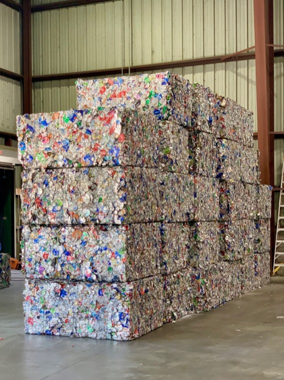 Bales of aluminum cans ready to be recycled.