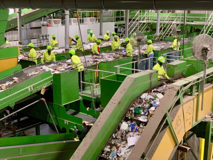 Workers sorting items at Single Stream Recyclers.