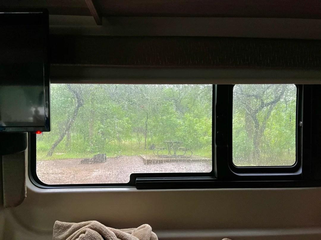 Rainy Day through Van Window - Plan an Unforgettable McKinney Falls State Park Camping Trip