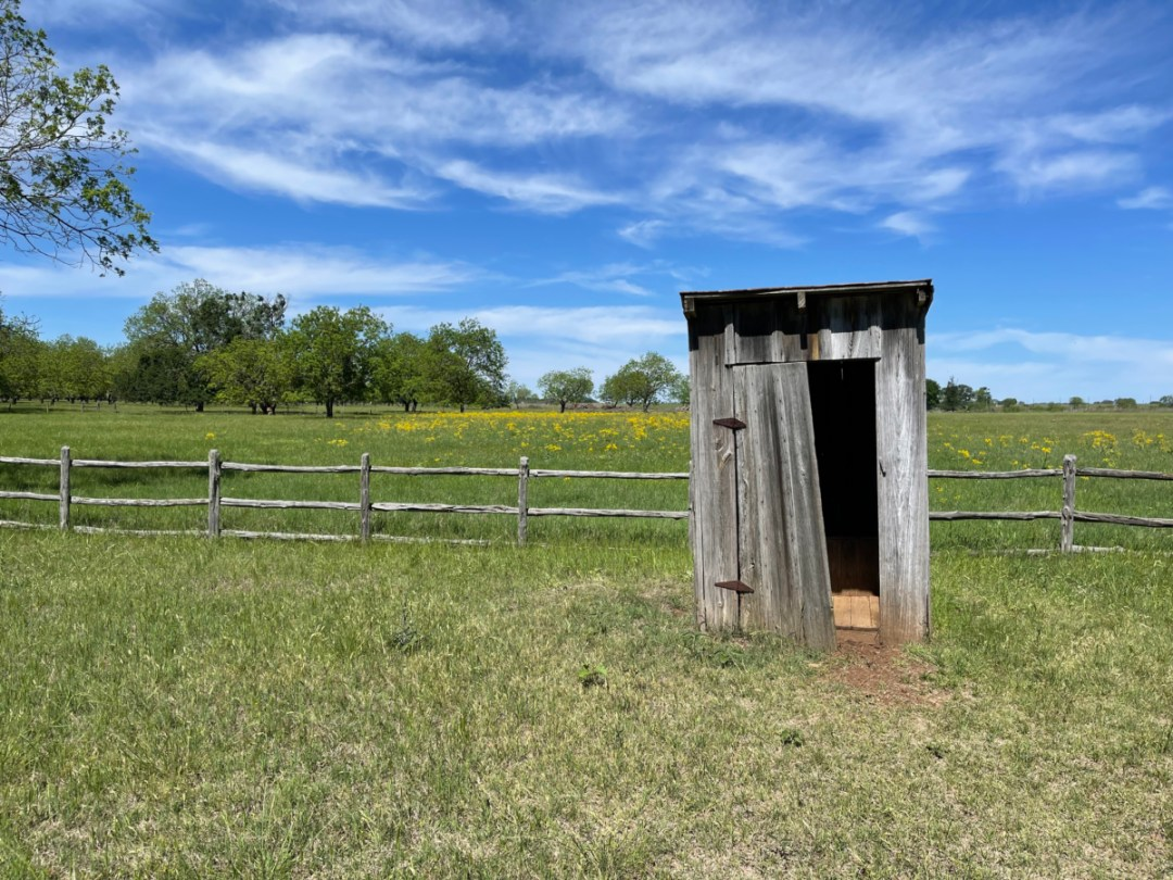 LBJ Birthplace outhouse - Explore LBJ Ranch and the Texas Hill Country
