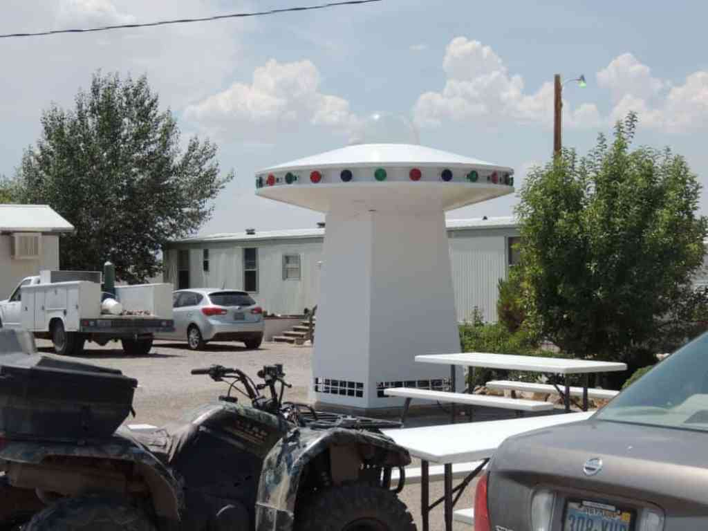 A small picnic area with a UFO sculpture next to it in Rachel, NV