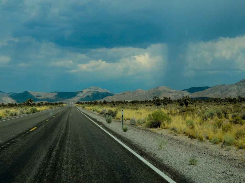 The lonely Extra Terrestrial Highway with mountains in the distance