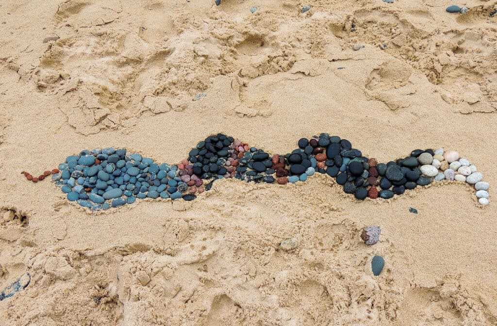 A snake made of rocks on Twelve Mile Beach at Pictured Rocks National Lakeshore