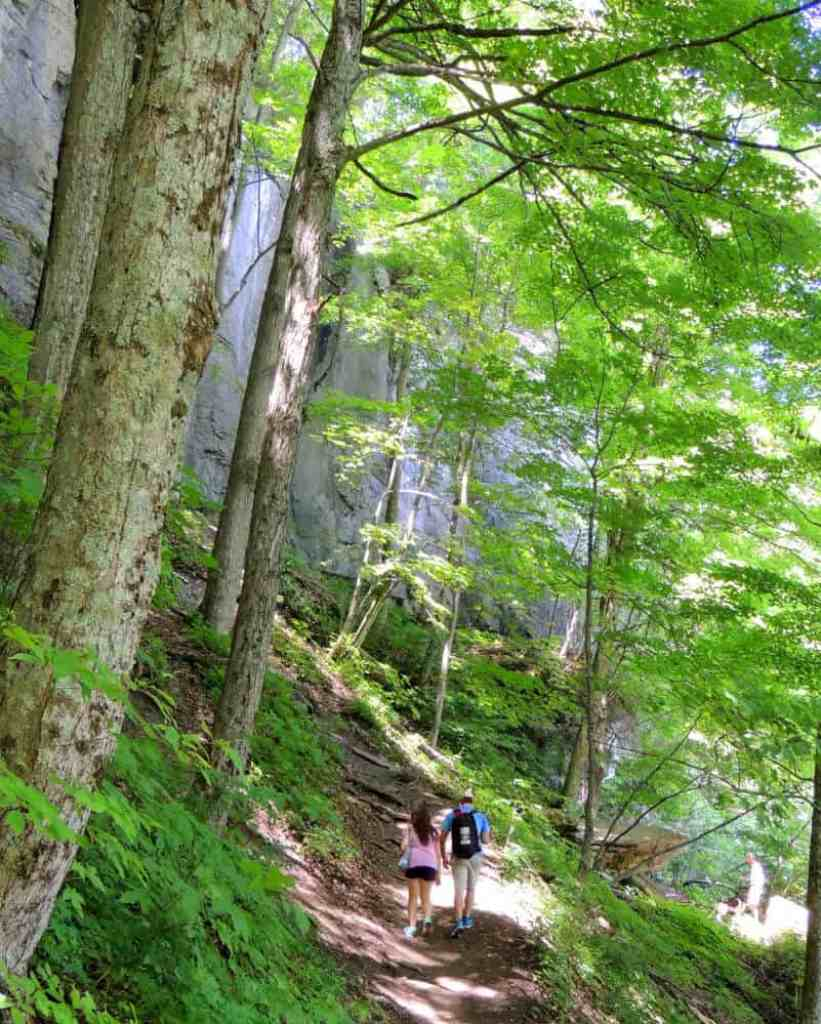 A couple hikes through the woods in a New York State Park