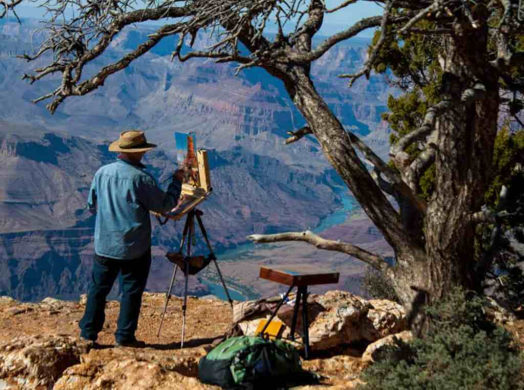 An artist paints the Desert View Watchtower in the Grand Canyon