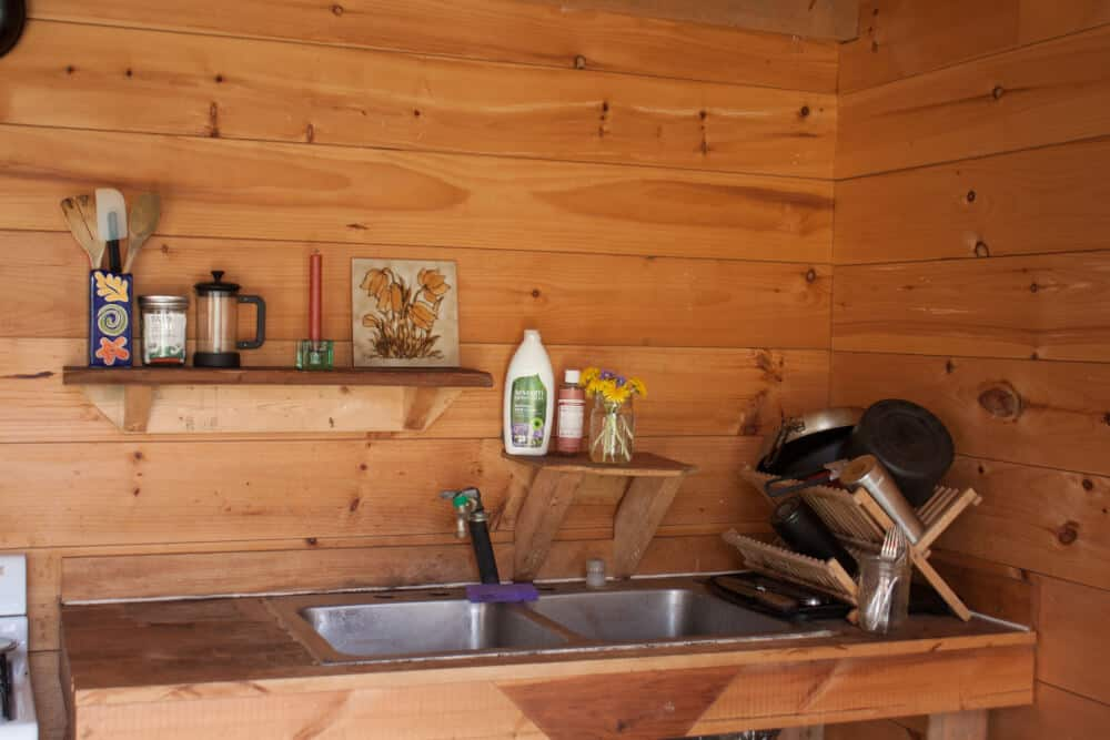 An interior shot of the kitchen in a cabin rental on Stony Pond Farm, Vermont