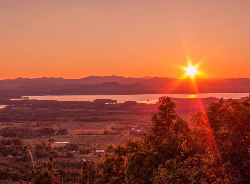 Sun setting behind the Adirondacks and Lake Champlain from the top of Mt. Philo