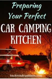 A red jeep parked next to a campfire. Caption: Preparing Your Perfect Car Camping Kitchen
