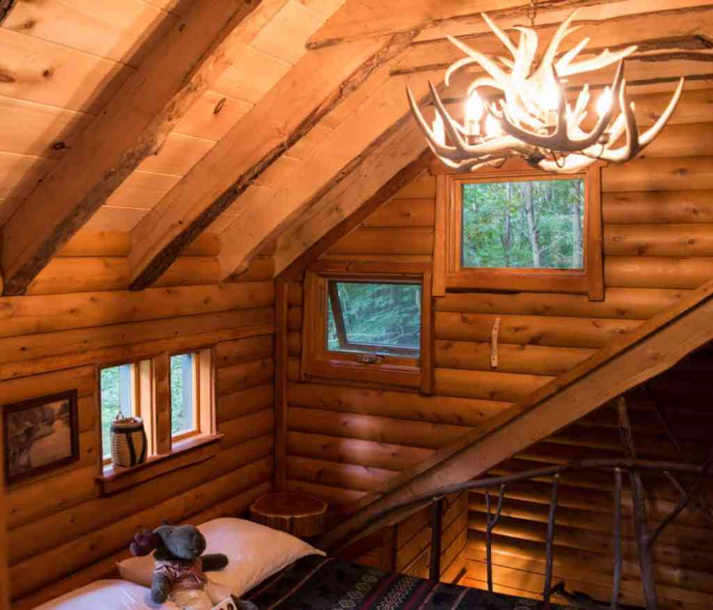 A view of the bedroom loft at the Moose Meadow Lodge Treehouse in Vermont
