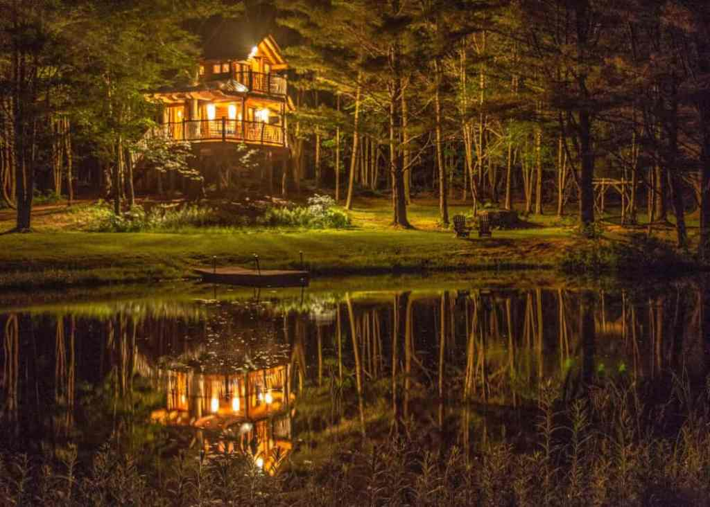 A nighttime view of the Vermont treehouse at Moose Meadow Lodge