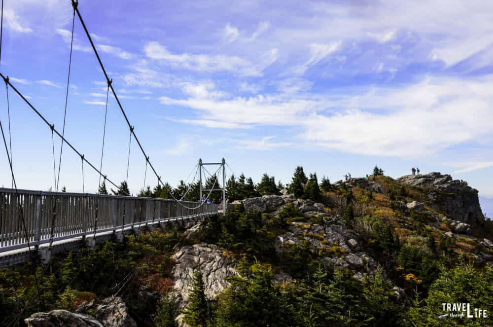 a suspension bridge stretching between rocks at Grandfather Mountain State Park